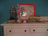 Laurel's dresser is adorned with art and jewelry.