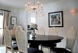 Shapely dining chairs and glamorous light fixtures take center stage in this dining room.