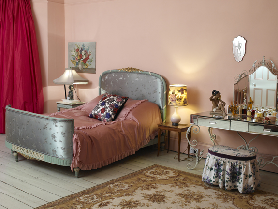 A palette of mauve, fuschia, and gray and loads of floral patterns make this bedroom quite Gone With the Wind meets Rachel Ashwell.
