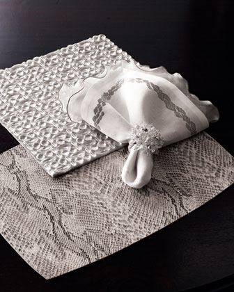 Pick up a set of your own Faux Snakeskin Place Mats ($152 for four) at Neiman Marcus.