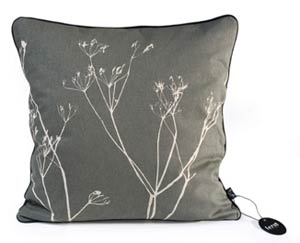 Toss some stylish flora-inspired pillows on your sofa. This Ferm Living Weed Pillow is subdued and pretty.