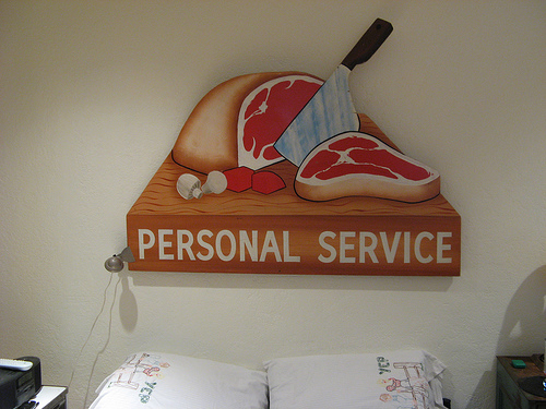 Andy repurposed a vintage butcher's shop sign that he now uses as the headboard for his bed.