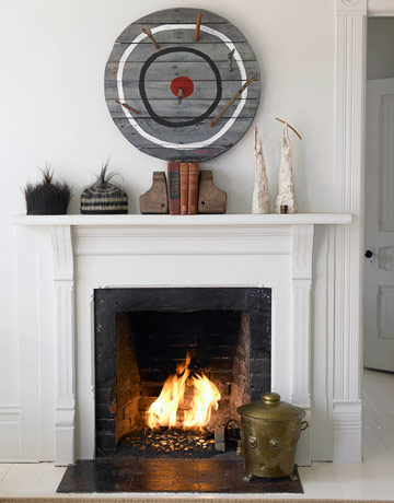 Above a fireplace, a bull's eye sculpture is contempo-country.