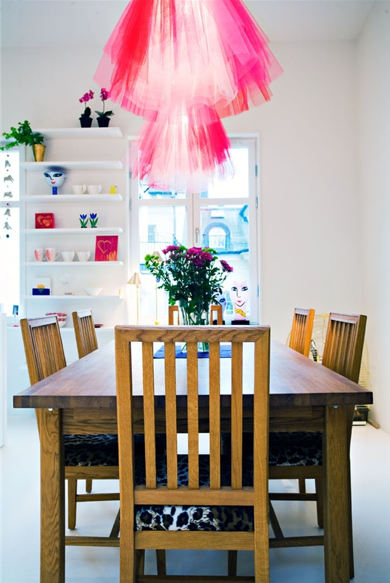 Tulle-skirted pink pendant lights offer bold femininity.