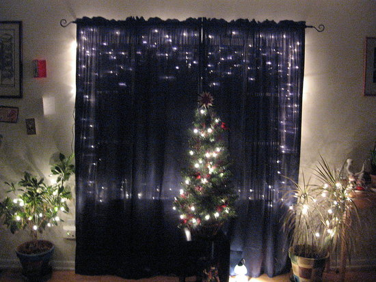 The exterior lights highlighted behind MandyPinecone's curtains create a cozy glow.