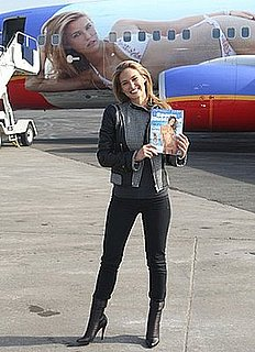 Model Bar Refaeli Wearing a Motorcycle Patchwork Leather Jacket at La Guardia Airport With Her Sports Illustrated Jet