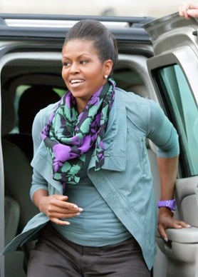 Michelle Obama Wearing a Mouthwash Green Rick Owens Jacket and Purple Watch in Paris