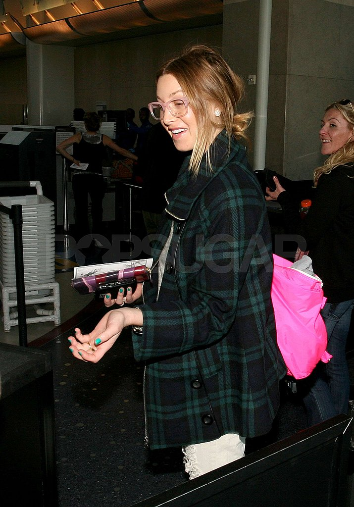 Whitney Shows off Her Bra at LAX