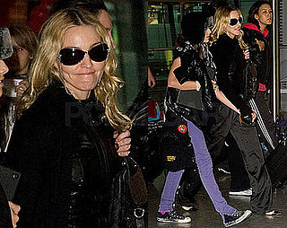 Photos of Madonna, Who's Written in a Malawian Newspaper of Her Desired Adoption of Mercy James, at Heathrow