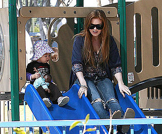 Photo of Isla Fisher and Olive Cohen on the Slides Together at an LA Park
