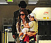 Photo Slide of Sacha Baron Cohen and Isla Fisher at LAX with Their Daughter Olive