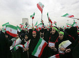 Tens of thousands of Iranians chanting anti-US slogans took to streets of Tehran for a mass rally marking 30 years since the Islamic revolution toppled the US-backed shah.