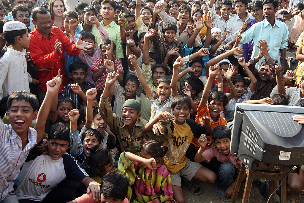Neighbors of Slumdog Millionaire child actor Mohammed Azharuddin Ismail watch the show.