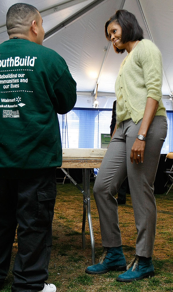 First Lady Michelle Obama wears green from head to toe, while touring an energy-efficient home construction project.