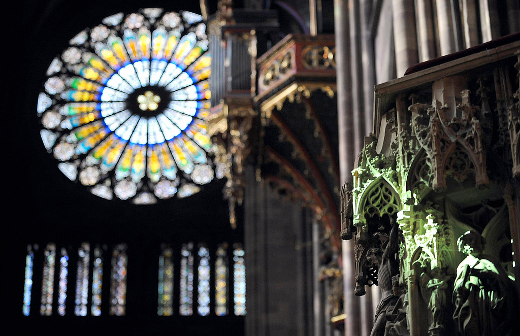 A green shaft of light illuminates statues of Jesus and saints in Strasbourg, France. The ray, from the cathedral's stained glass window, appears every year at midday on the vernal equinox.