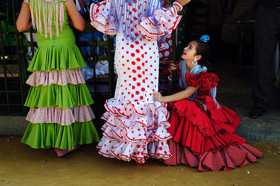 Women Dressed in Flamenco Splash Spain With Color
