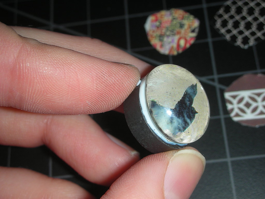 Now, press the découpaged glass gem onto the magnet, set down, and let dry.