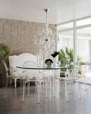 The pairing of a Lucite table and a set of Louis Ghost chairs is a bold move, making this Palm Springs dining room nearly translucent, but it works flawlessly. Source