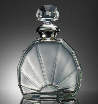 The Ralph Lauren Art Deco Glass Decanter ($1,950) sparkles with a similar three-dimensional fan design.
