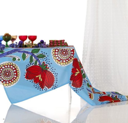 Freshen your table by spreading a gorgeous, vibrant cloth across it. It'll instantly add a Spring touch to your home.