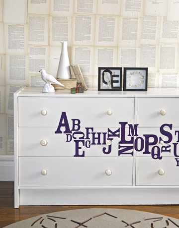 Use paint and wall stickers to update a tired old dresser.  Source
