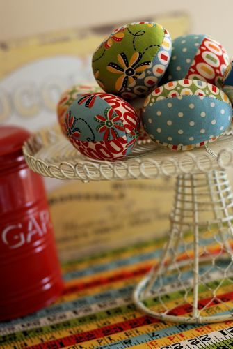 Retro Mama stitches up fabric Easter eggs.