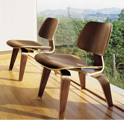 "The Eames Molded Plywood Lounge Chair ($679-1,229) has been referred to as the ""most famous chair of the century."" The couple designed it in 1946 after turning a spare room in their California home into a plywood workshop. Its form relates directly to the human body, holding no secrets as to how it succeeds technically."