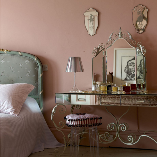 Nearly over the top in its femininity, the mirrored vanity with a curlicue ironwork base is the showstopper in the room. Definitely for ladies only, who wouldn't want to spend at least one night in this sweetly feminine space? Source