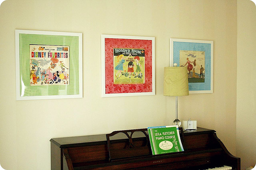 Pink Picket Fence shows you how to turn childhood albums into charming wall art.