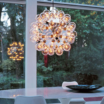 I'm in love with this Taraxacum 88 Chandelier ($4,984). It was designed by Achille Castiglioni in 1988, and is crafted from aluminum and glass. However, given its high price point, I might just make my own version.