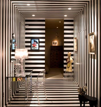 And last but not least, this powder room in the home of a Domino reader is decked head-to-toe in horizontal and vertical stripes, giving the small space a big presence. Source