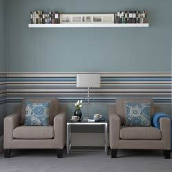Horizontal stripes act as visual wainscoting in this living room. Source