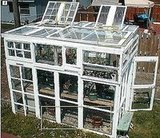 Take the window creativity outdoors. If you've got a lot of gumption, you can make a green house out of old windows.