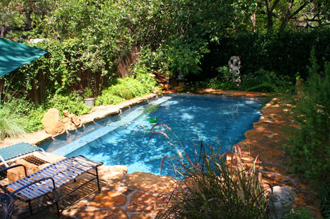 The pool is located on the footprint of the original turn-of-the-century house's dirt basement. The home had been demolished years ago, but the remaining basement area saved the owners the necessary excavation for the pool.