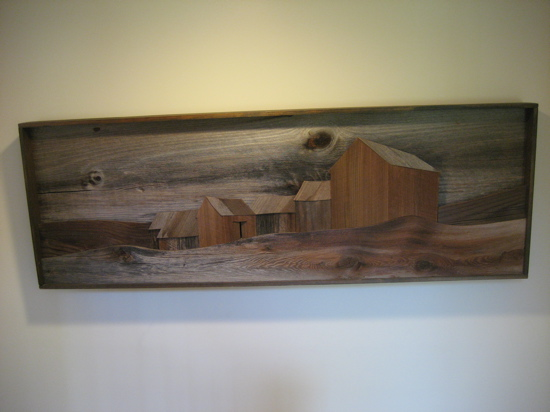 Artist John Long built this wall sculpture from weathered barn wood.