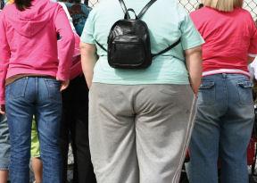 Obesity spreads in social networks