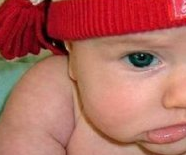 Cute Baby Pouts in Christmas Beanie