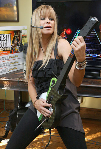 Carmen Electra Gets Down With Guitar Hero