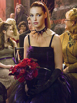 VAMPIRE PRINCESS Heigl accessorizes a short strapless gown with a spiked choker for a friend's goth nuptials.