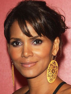 Halle Berry has an oval face and looks best with fringe