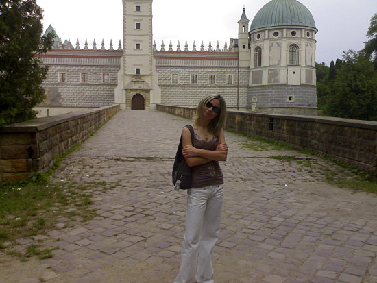 I on the background of the old castle in Krasiczyn